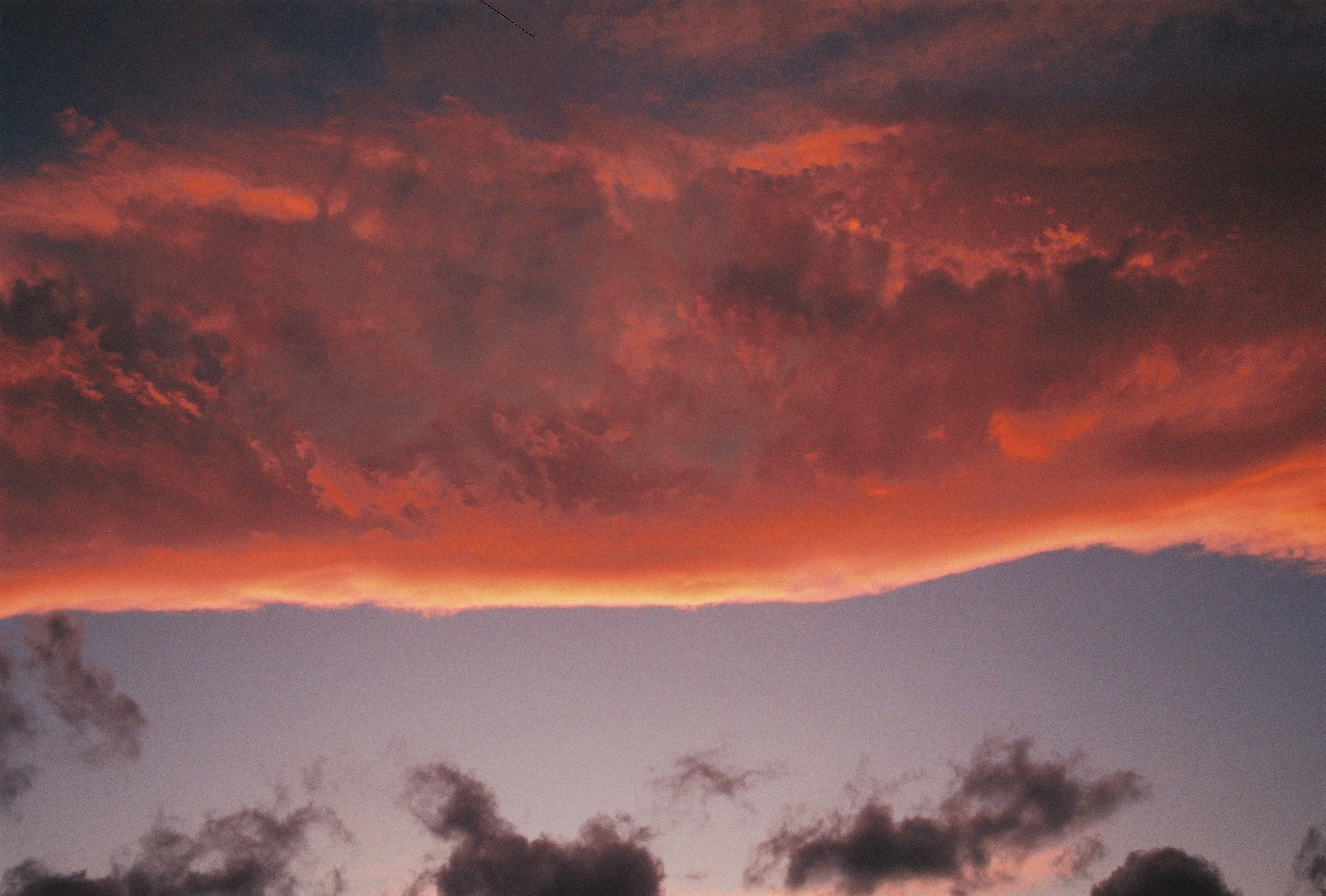 a troubled sunset with strange clouds